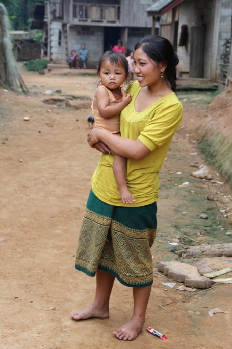 Woman with child in a river village in Laos