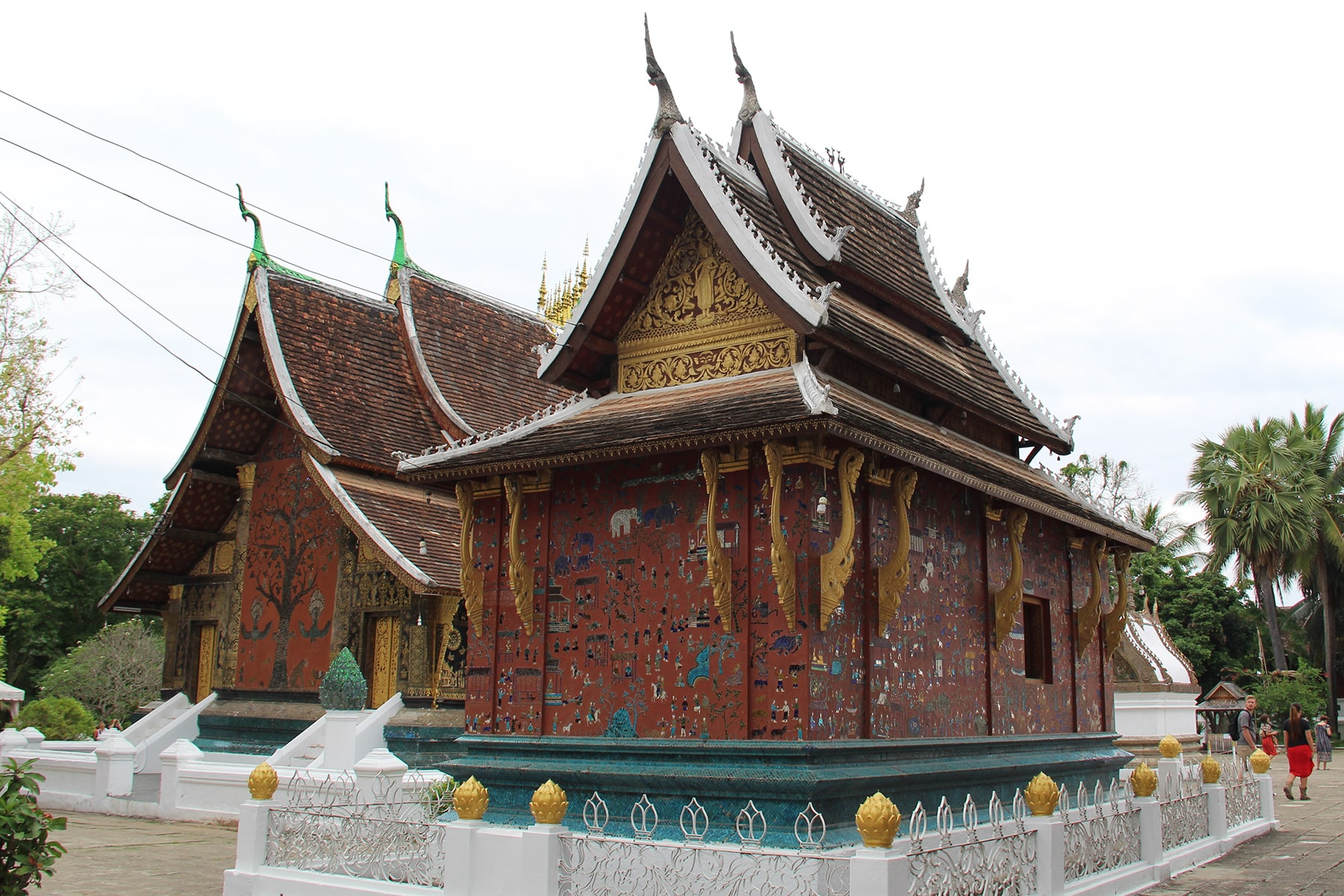 Two decorated chapels in the Wat Xieng Thong, Laos