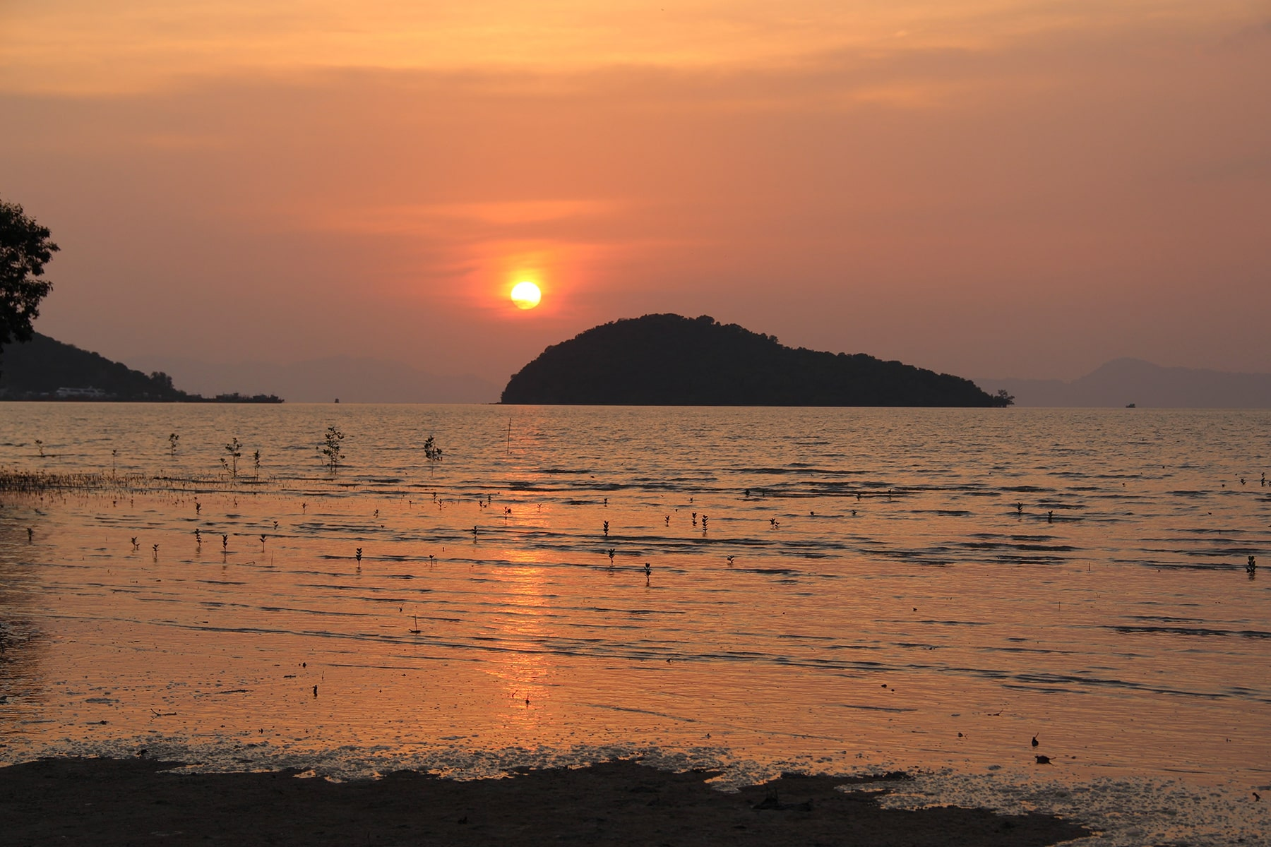 Sunset in Koh Yao Yai with the shadow of an island