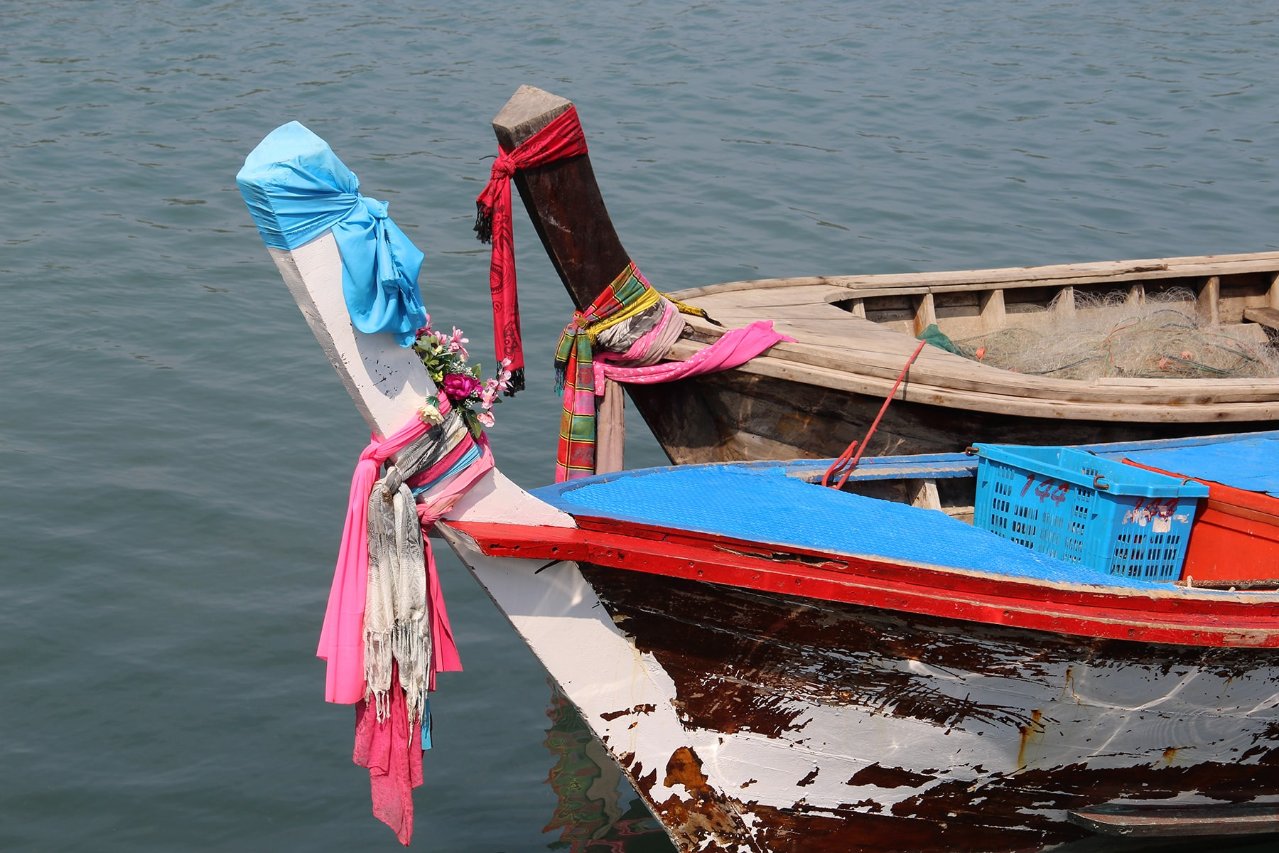 Colourful offerings on boats in Koh Yao Yai
