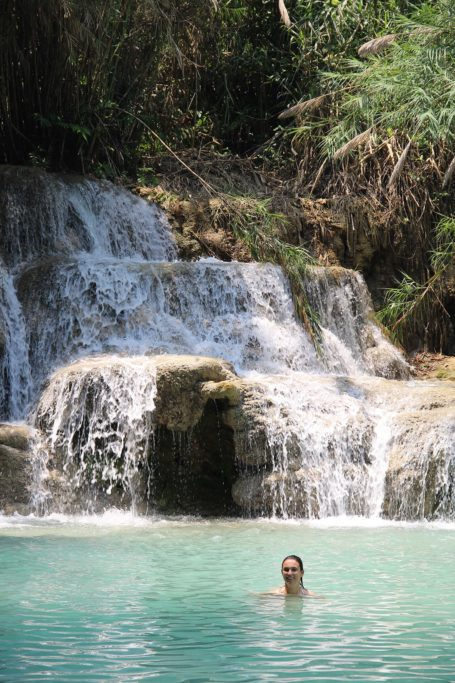 Marianna swims in a natural pool of Kuang Si in Laos