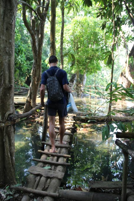 Little wooden bridges on top of Kuang Si waterfalls in Laos