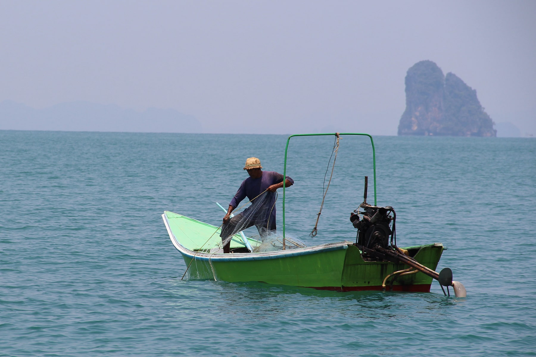 Koh Yao Yai fisherman on his boat