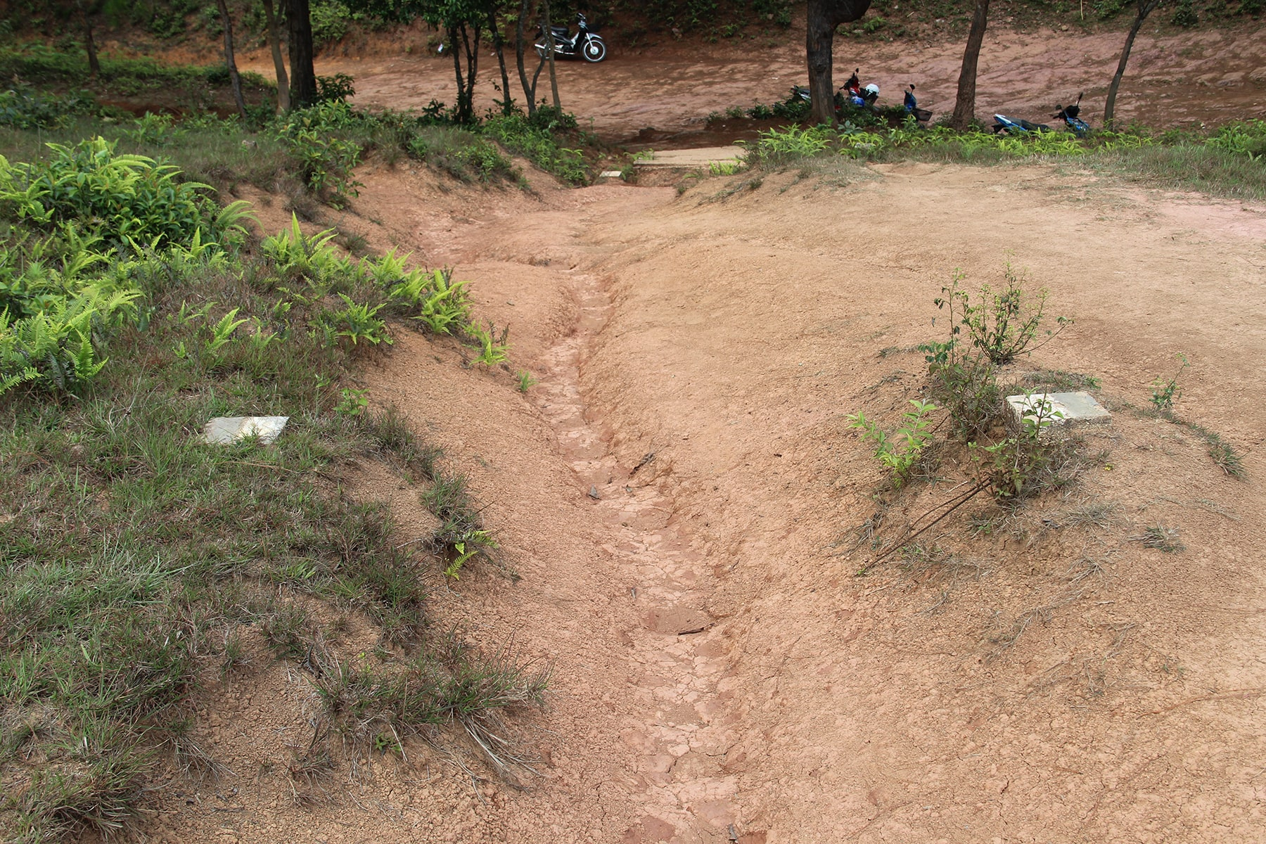 MAG signs on Phonsavan Jar Site path, Laos