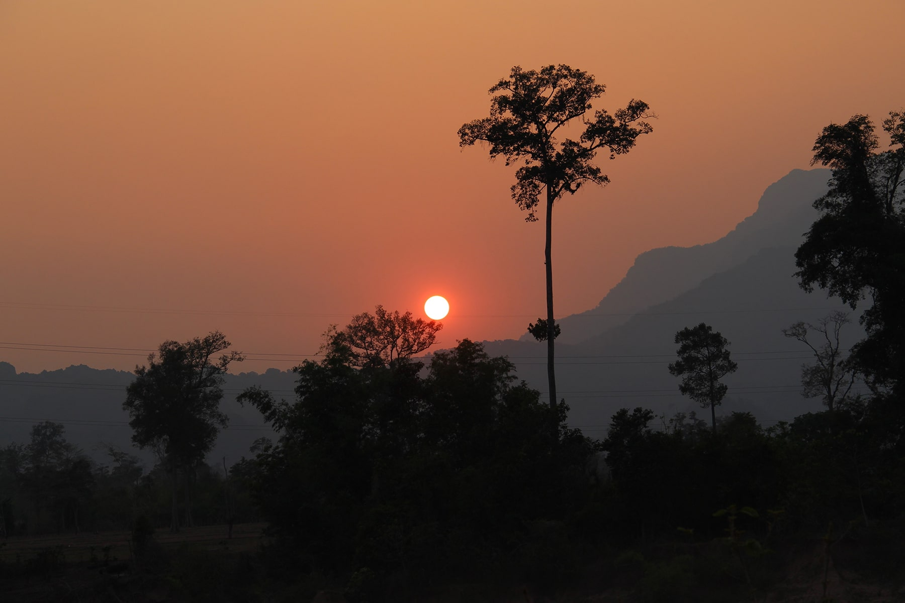The sunset behind the mountains Thakek loop Laos
