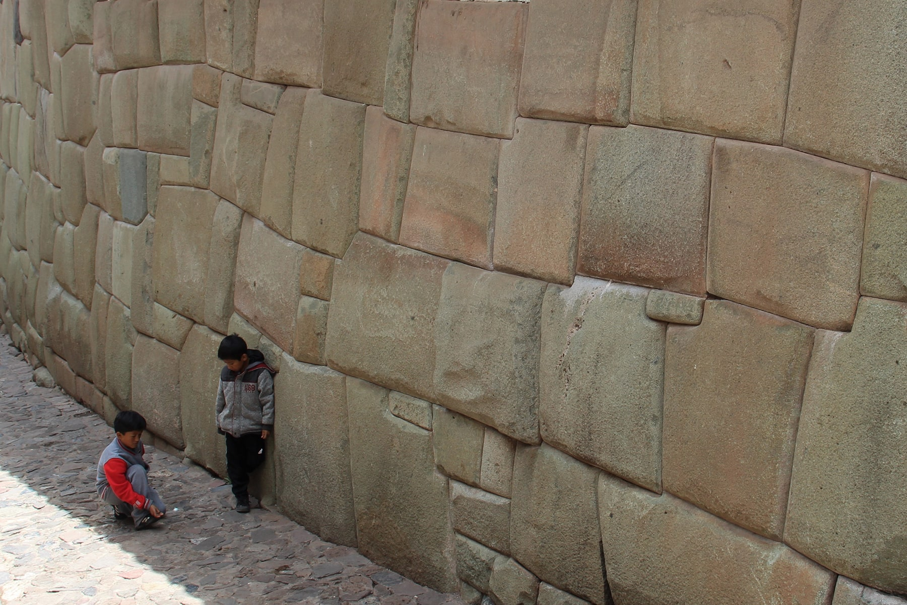 Kids in front of Inca wall