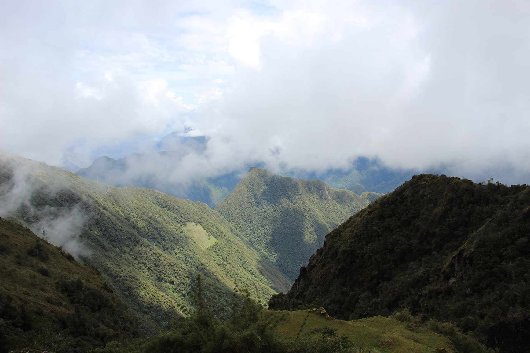 View on the mountains plunged in the fog on inca trail