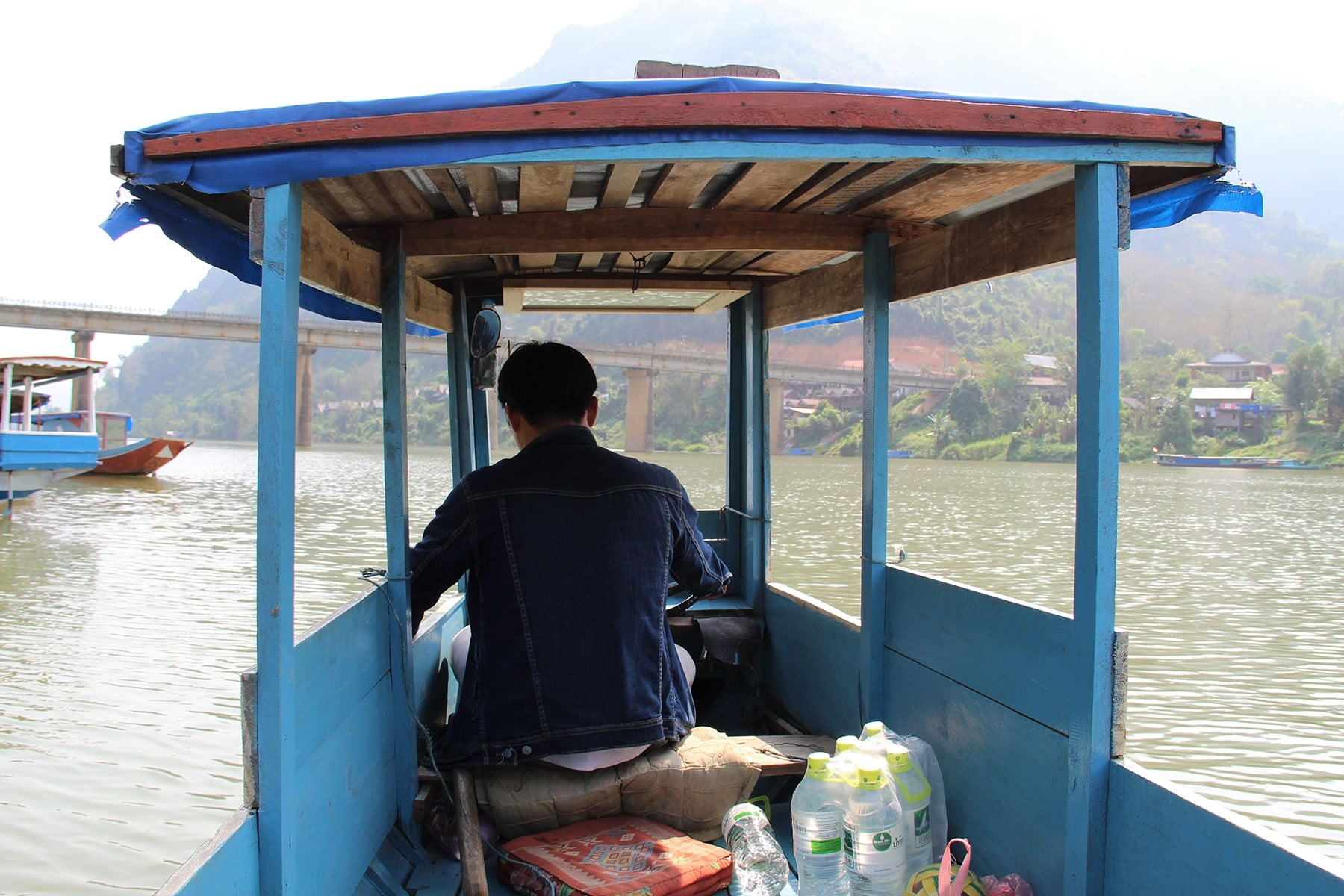 Blue boat to river villages in Laos