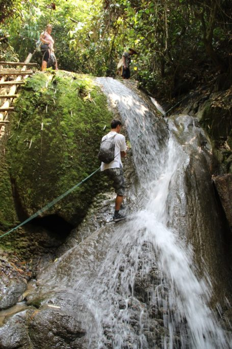 Florian climbing a waterfall in Nong Khiaw, Laos