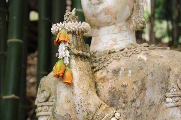 Praying hands with flower crown in Wat Pha Lat, Chiang Mai