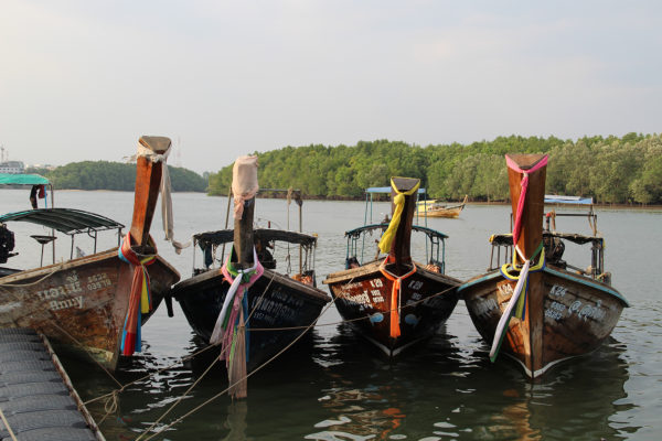 Longtail boats in Koh Yao Yai with colourful tissues