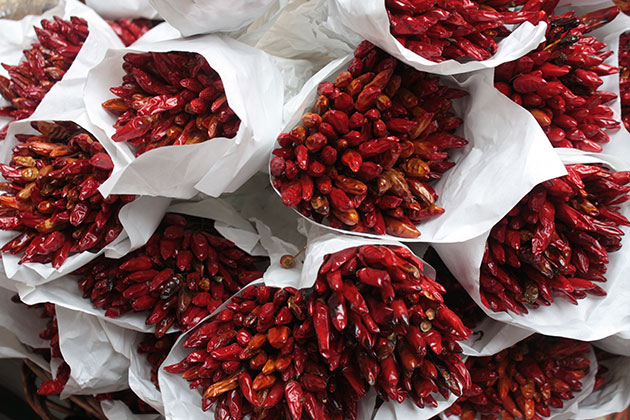 Bunches of red hot chilli peppers at an Italian market